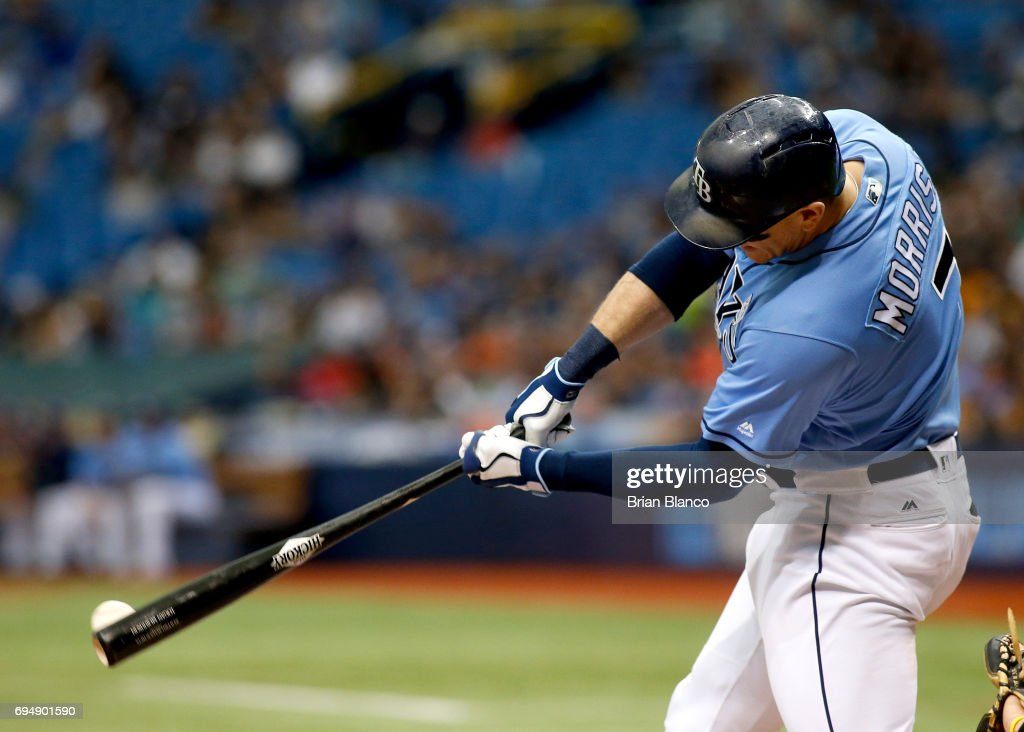 Logan Morrison #7 of the Tampa Bay Rays hits a double down the left field line off of pitcher Jesse Hahn of the Oakland Athletics during the fifth inning of a game on June 11, 2017 at Tropicana Field in St. Petersburg, Florida.