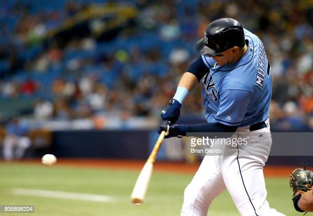 Logan Morrison of the Tampa Bay Rays hits a fielder's choice off of pitcher Yovani Gallardo of the Seattle Mariners during the first inning of a game...