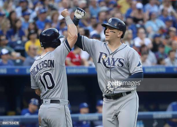 Logan Morrison of the Tampa Bay Rays is congratulated by Corey Dickerson after hitting a threerun home run in the third inning during MLB game action...