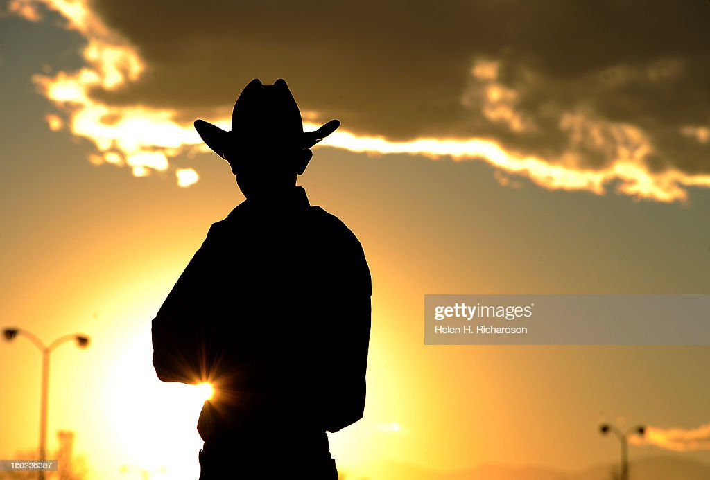 Logan Olson of Stephenville, Texas, watches the sunset before he packs up his trailer before heading out after the end of the stock show. Olson participated in the team roping event of the rodeo. The final day of the 2013 National Western Stock show was Sunday, January 27th. One of the big events for the day was the PRCA Pro Rodeo finals in the Coliseum. The event featured bareback riding, steer wrestling, team roping, saddle bronc riding, tie down roping, barrel racing and bull riding.