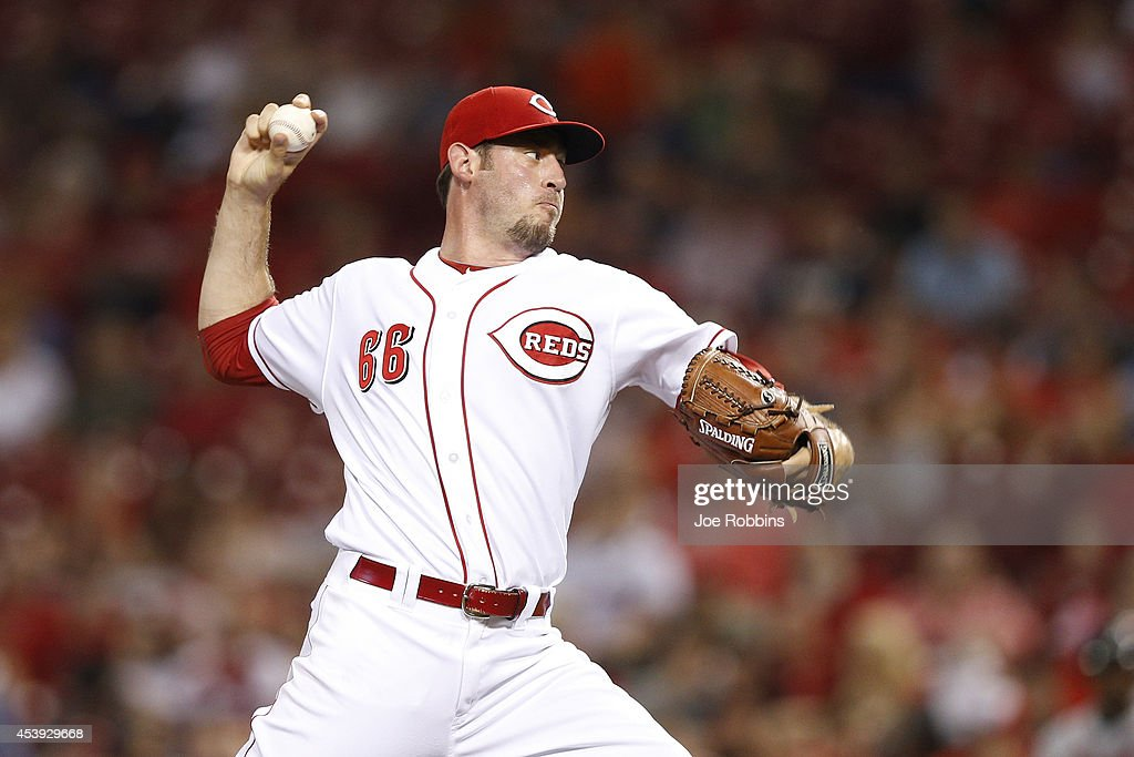 Logan Ondrusek #66 of the Cincinnati Reds pitches in the seventh inning of the game against the Atlanta Braves at Great American Ball Park on August 21, 2014 in Cincinnati, Ohio.