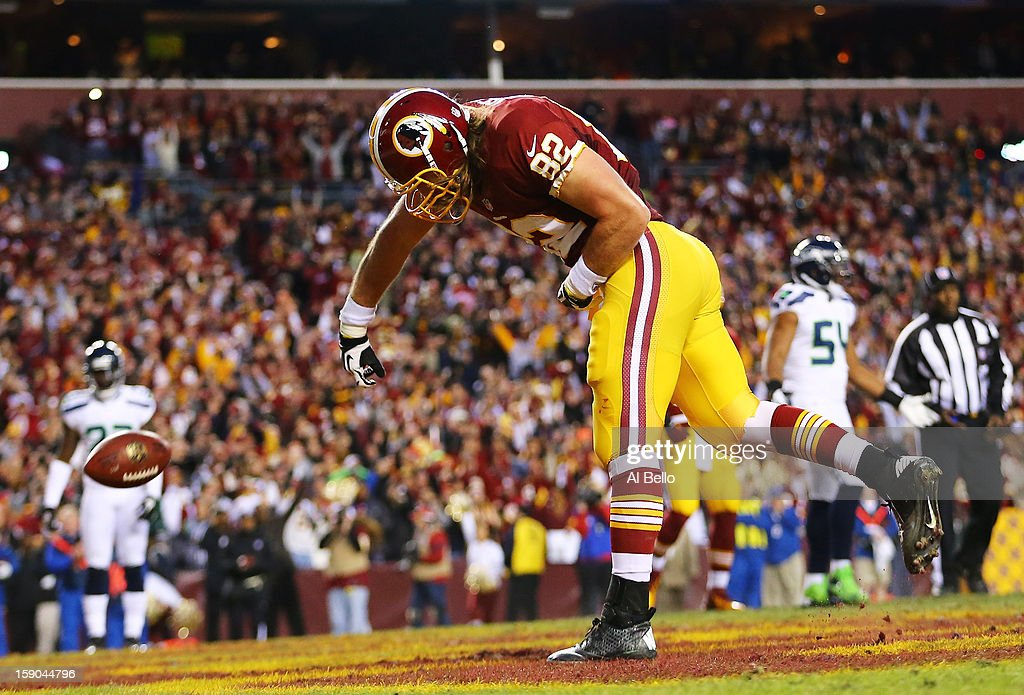 Logan Paulsen #82 of the Washington Redskins celebrates his first quarter touchdown against the Seattle Seahawks during the NFC Wild Card Playoff Game at FedExField on January 6, 2013 in Landover, Maryland.