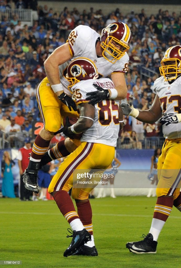 <a gi-track='captionPersonalityLinkClicked' href=/galleries/search?phrase=Logan+Paulsen&family=editorial&specificpeople=2934776 ng-click='$event.stopPropagation()'>Logan Paulsen</a> #82 of the Washington Redskins congratulates teammate Leonard Hankerson #85 on scoring a touchdown against the Tennessee Titans during a pre-season game at LP Field on August 8, 2013 in Nashville, Tennessee.