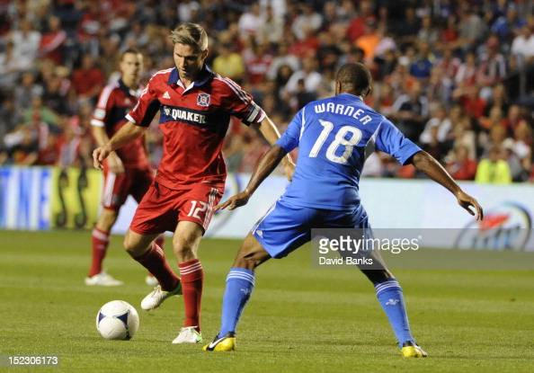 Logan Pause of Chicago Fire takes a shot as Collen Warner of Montreal Impact defends in an MLS match on September 15 2012 at Toyota Park in...