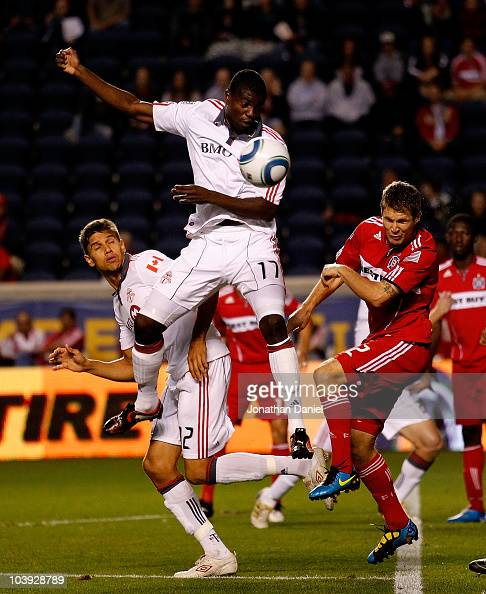 Logan Pause of the Chicago Fire heads the ball away from O'Brian White and Adrian Cann of Toronto FC in an MLS match on September 8 2010 at Toyota...