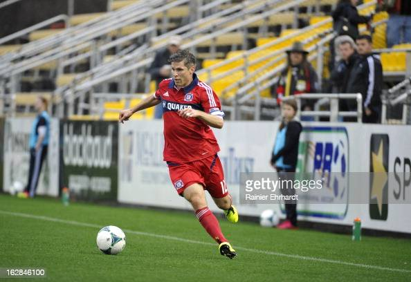 Logan Pause of the Chicago Fire looks to pass against the Vancouver Whitecaps FC during the first half of the Carolina Challenge Cup at Blackbaud...