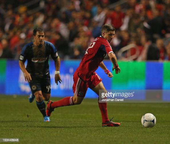 Logan Pause of the Chicago Fire moves in front of Danny Cruz of the Philadelphia Union during an MLS match at Toyota Park on October 3 2012 in...