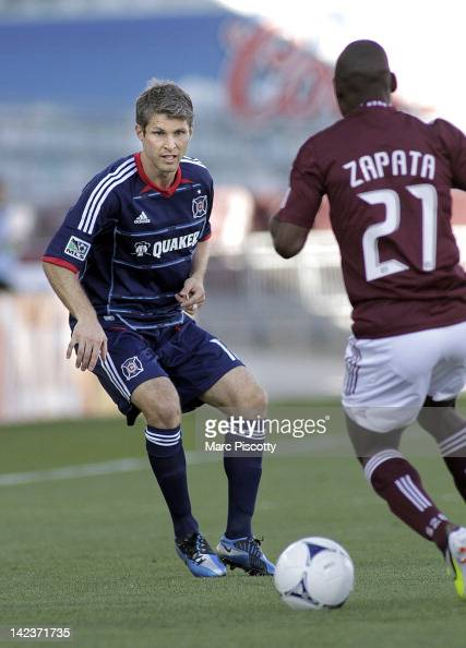 Logan Pause of the Chicago Fire plays against Luis Zapata of the Colorado Rapids during their game at Dick's Sporting Goods Park April 1 2012 in...