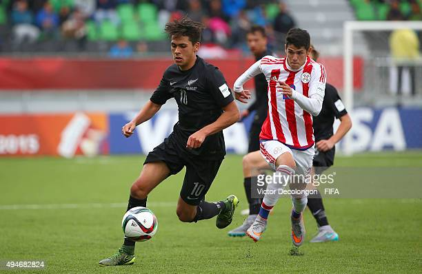 Logan Rogerson of New Zealand plays the ball upfield as Julio Villalba of Paraguay gives chase during the Paraguay v New Zealand Group F FIFA U17...