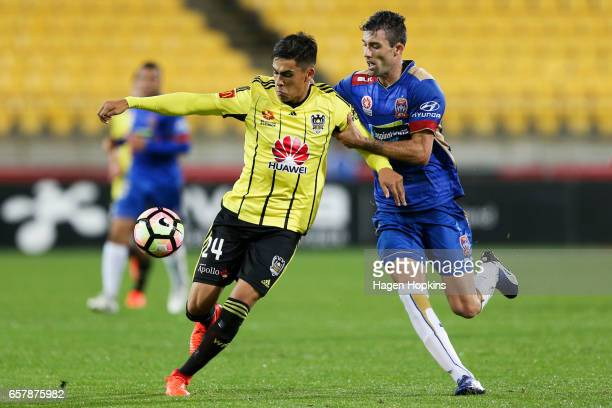 Logan Rogerson of the Phoenix is challenged by Jason Hoffman of the Jets during the round 24 ALeague match between Wellington Phoenix and Newcastle...