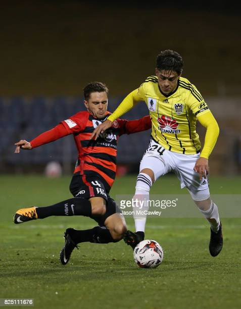 Logan Rogerson of the Phoenix is challenged by Josh Risdon of the Wanderers during the FFA Cup round of 32 match between the Western Sydney Wanderers...
