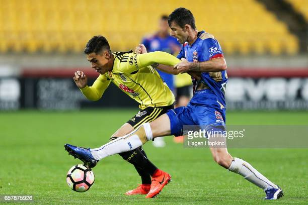 Logan Rogerson of the Phoenix is tackled by Jason Hoffman of the Jets during the round 24 ALeague match between Wellington Phoenix and Newcastle Jets...
