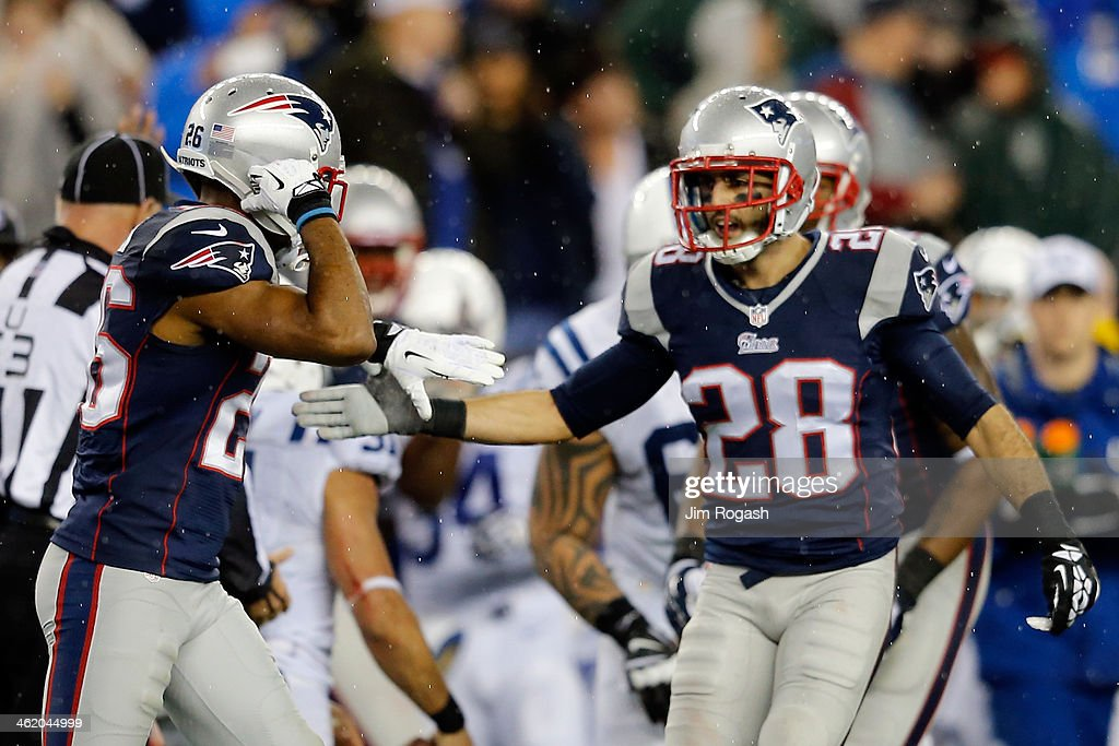 <a gi-track='captionPersonalityLinkClicked' href=/galleries/search?phrase=Logan+Ryan&family=editorial&specificpeople=8222226 ng-click='$event.stopPropagation()'>Logan Ryan</a> #26 and Steve Gregory #28 of the New England Patriots react after a play against the Indianapolis Colts during the AFC Divisional Playoff game at Gillette Stadium on January 11, 2014 in Foxboro, Massachusetts.