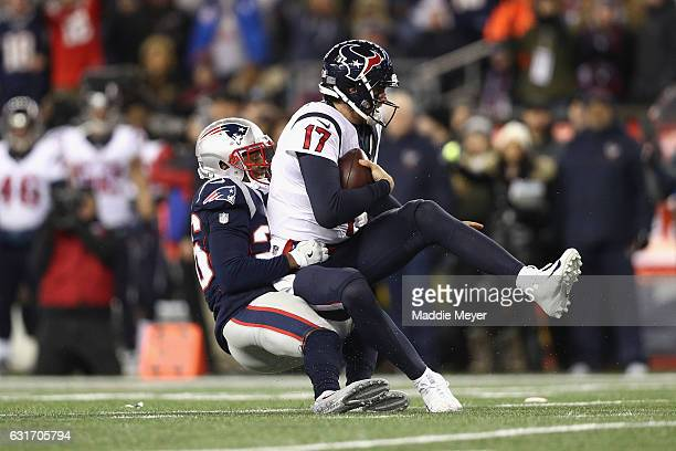 Logan Ryan of the New England Patriots sacks Brock Osweiler of the Houston Texans in the first half during the AFC Divisional Playoff Game at...