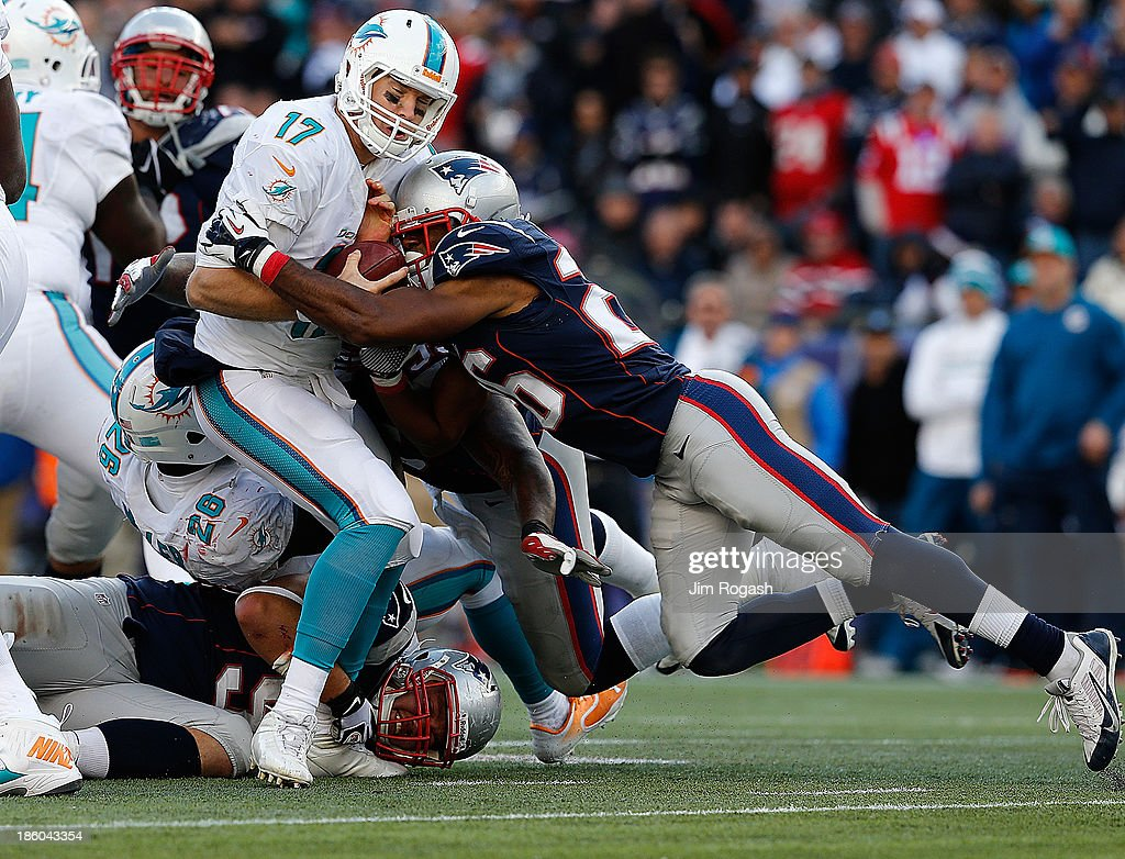 <a gi-track='captionPersonalityLinkClicked' href=/galleries/search?phrase=Logan+Ryan&family=editorial&specificpeople=8222226 ng-click='$event.stopPropagation()'>Logan Ryan</a> #26 of the New England Patriots sacks <a gi-track='captionPersonalityLinkClicked' href=/galleries/search?phrase=Ryan+Tannehill&family=editorial&specificpeople=5573174 ng-click='$event.stopPropagation()'>Ryan Tannehill</a> #17 of the Miami Dolphins in the second half at Gillette Stadium on October 27, 2013 in Foxboro, Massachusetts.