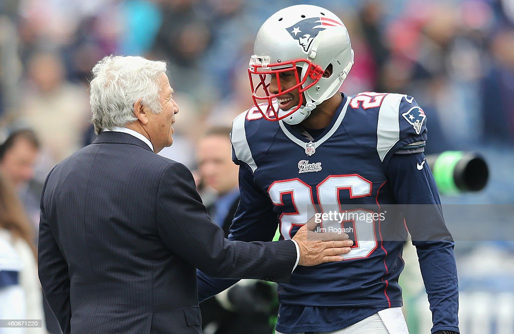<a gi-track='captionPersonalityLinkClicked' href=/galleries/search?phrase=Logan+Ryan&family=editorial&specificpeople=8222226 ng-click='$event.stopPropagation()'>Logan Ryan</a> #26 of the New England Patriots speaks with team owner <a gi-track='captionPersonalityLinkClicked' href=/galleries/search?phrase=Robert+Kraft&family=editorial&specificpeople=221220 ng-click='$event.stopPropagation()'>Robert Kraft</a> before a game agsint the Buffalo Bills at Gillette Stadium on December 28, 2014 in Foxboro, Massachusetts.