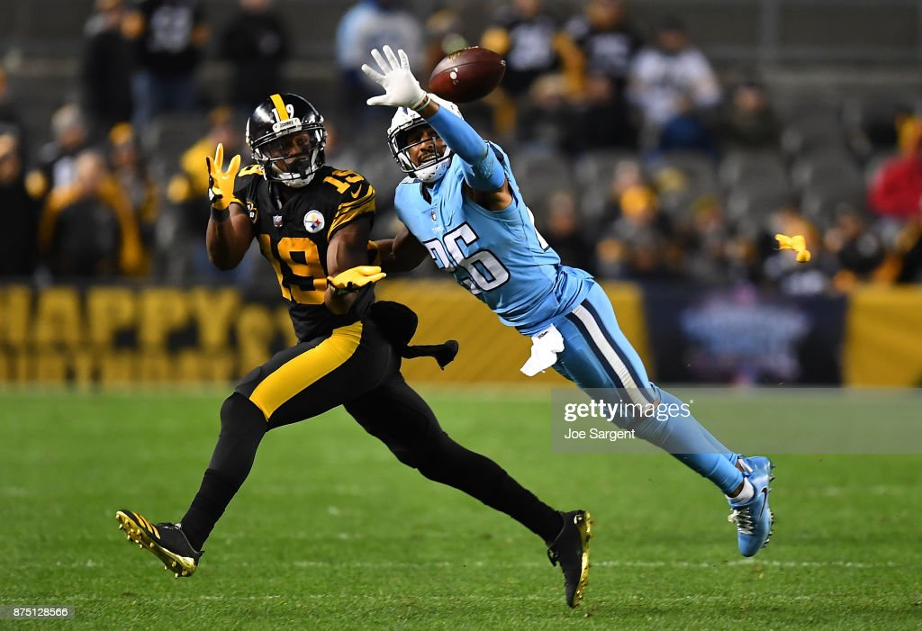 Logan Ryan #26 of the Tennessee Titans knocks the ball away from JuJu Smith-Schuster #19 of the Pittsburgh Steelers as he tries to make a catch in the first half during the game at Heinz Field on November 16, 2017 in Pittsburgh, Pennsylvania.