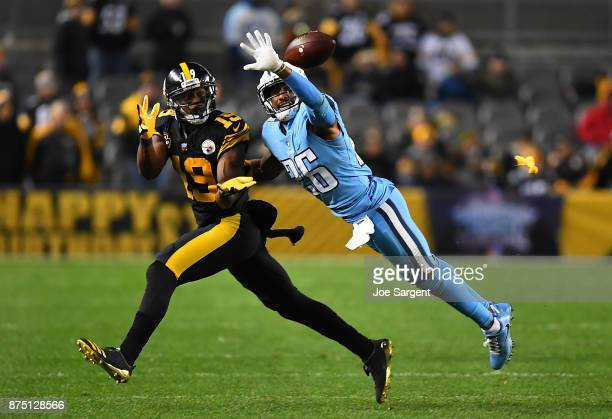 Logan Ryan of the Tennessee Titans knocks the ball away from JuJu SmithSchuster of the Pittsburgh Steelers as he tries to make a catch in the first...