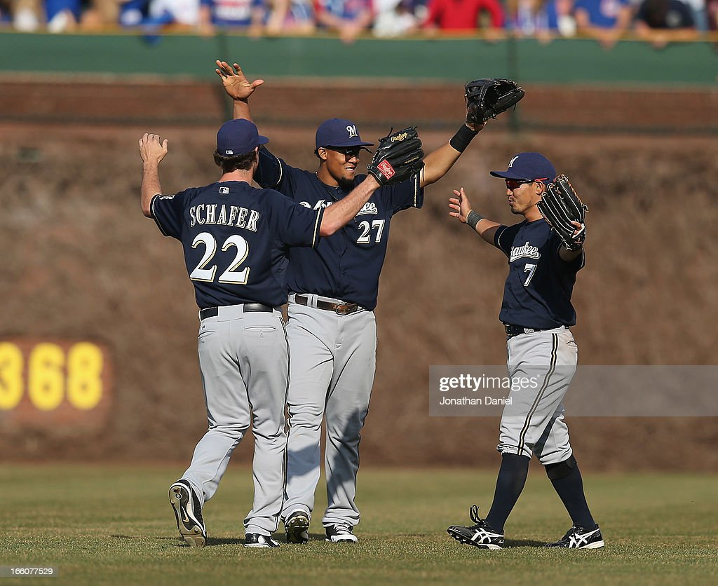 Logan Schafer #22, Carlos Gomez #27 and <a gi-track='captionPersonalityLinkClicked' href=/galleries/search?phrase=Norichika+Aoki&family=editorial&specificpeople=850957 ng-click='$event.stopPropagation()'>Norichika Aoki</a> #7 of the Milwaukee Brewers celebrate a win over the Chicago Cubs after the Opening Day game at Wrigley Field on April 8, 2013 in Chicago, Illinois. The Brewers defeated the Cubs 7-4.
