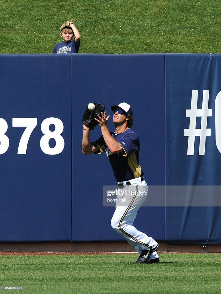 Logan Schafer #22 of the Milwaukee Brewers catches a fly ball against the Los Angeles Angels of Anaheim at Maryvale Baseball Park on March 19, 2013 in Maryvale, Arizona.