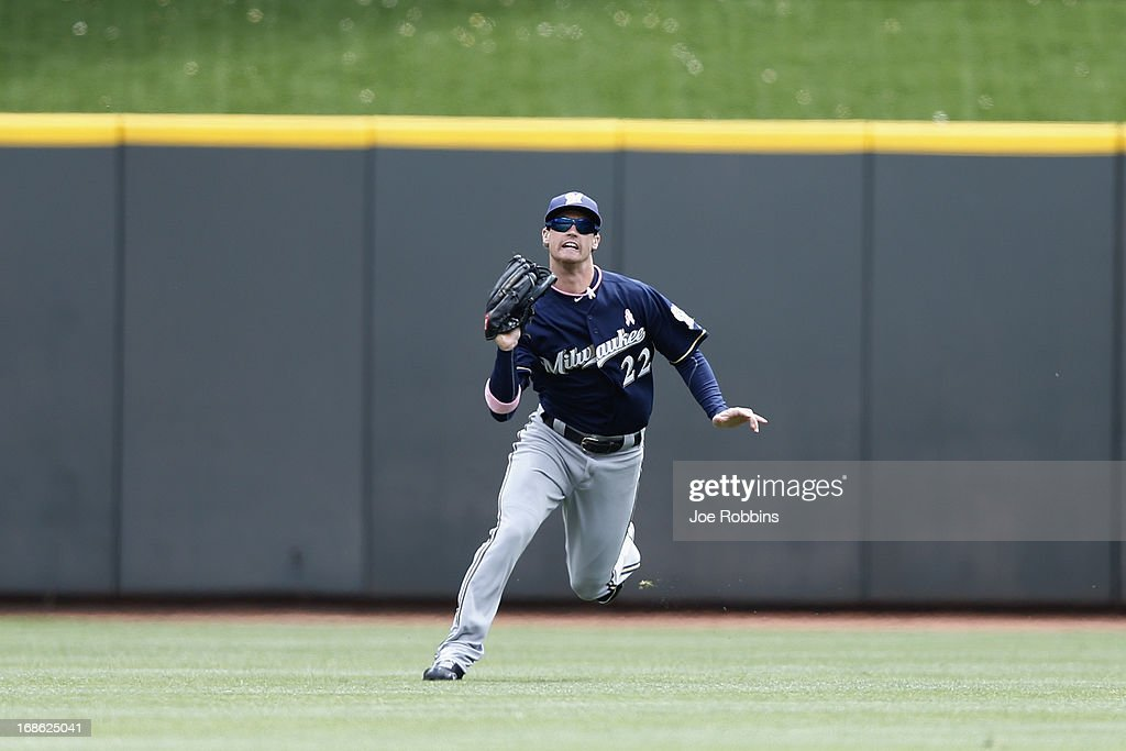 Logan Schafer #22 of the Milwaukee Brewers makes a catch in the outfield against the Cincinnati Reds during the game at Great American Ball Park on May 12, 2013 in Cincinnati, Ohio. The Reds won 5-1.