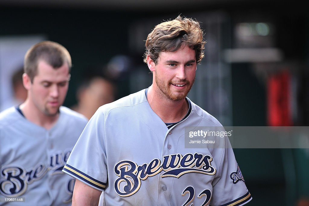 Logan Schafer #22 of the Milwaukee Brewers takes a breather in the dugout in the sixth inning against the Cincinnati Reds at Great American Ball Park on June 15, 2013 in Cincinnati, Ohio. Schafer had two doubles and two RBIs as Milwaukee blanked Cincinnati 6-0.