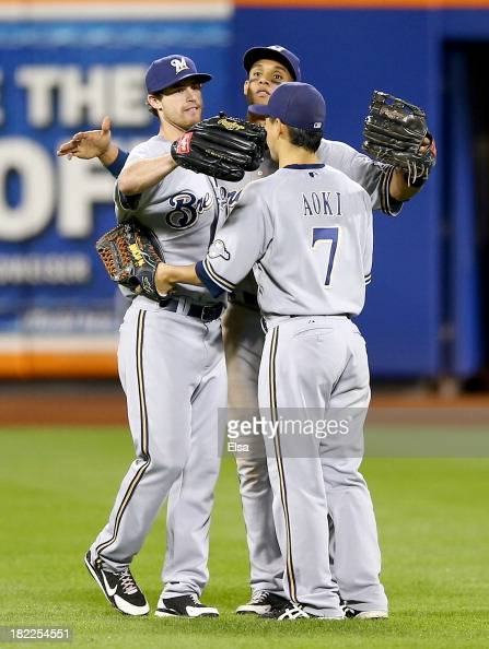 Logan SchaferCarlos Gomez and Norichika Aoki of the Milwaukee Brewers celebrate the win over the New York Mets on September 28 2013 at Citi Field in...