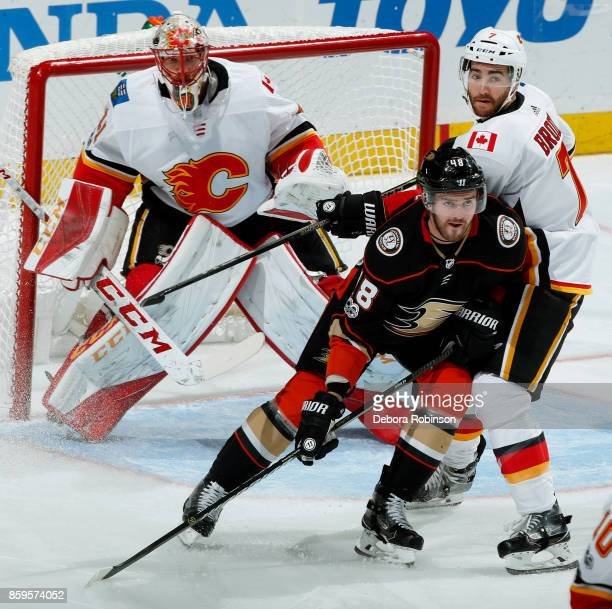 Logan Shaw of the Anaheim Ducks battles in front of the net against TJ Brodie and Mike Smith of the Calgary Flames during the game on October 9 2017...