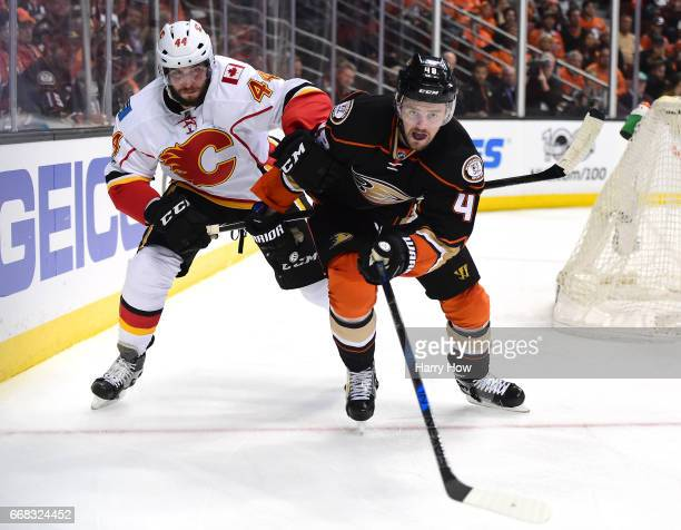 Logan Shaw of the Anaheim Ducks races after the puck with Matt Bartkowski of the Calgary Flames during a 32 Ducks win in Game One of the Western...