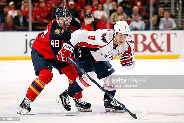 Logan Shaw of the Florida Panthers tangles with Dmitry Orlov of the Washington Capitals at the BBT Center on December 10 2015 in Sunrise Florida