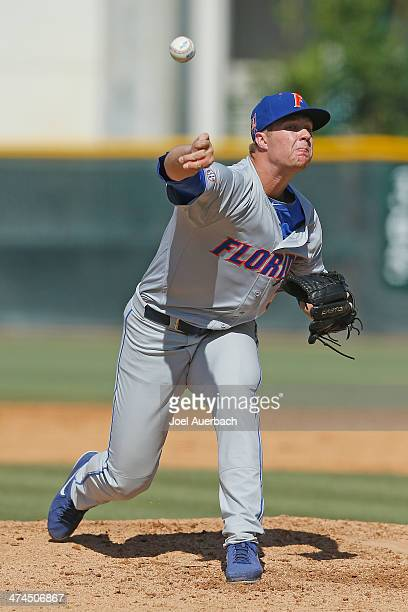 Logan Shore of the Florida Gators throws the ball against the Miami Hurricanes in the fifth inning on February 23 2014 at Alex Rodriguez Park at Mark...