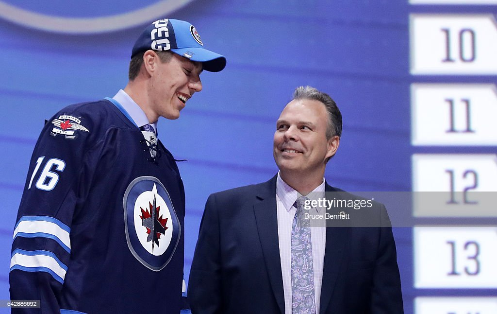 Logan Stanley celebrates with the Winnepeg Jets after being selected 18th during round one of the 2016 NHL Draft on June 24, 2016 in Buffalo, New York.