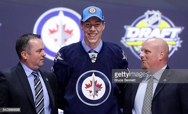 Logan Stanley celebrates with the Winnepeg Jets after being selected 18th during round one of the 2016 NHL Draft on June 24 2016 in Buffalo New York