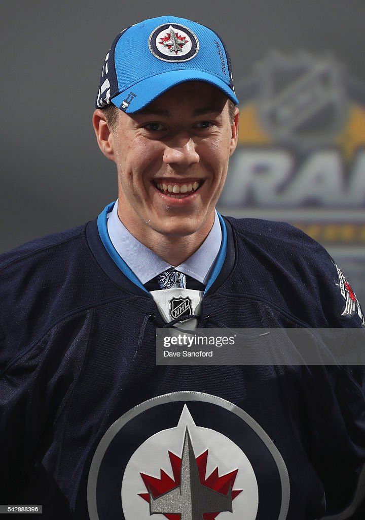 <a gi-track='captionPersonalityLinkClicked' href=/galleries/search?phrase=Logan+Stanley&family=editorial&specificpeople=13577034 ng-click='$event.stopPropagation()'>Logan Stanley</a>, selected 18th overall by the Winnipeg Jets, poses onstage during round one of the 2016 NHL Draft at First Niagara Center on June 24, 2016 in Buffalo, New York.