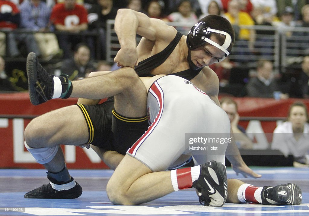 Logan Steiber of the Ohio State Buckeyes wrestles Tony Ramos of the Iowa Hawkeyes in the 133-pound championship match at the 2013 NCAA Wrestling Championships on March 23, 2013 at Wells Fargo Arena in Des Moines, Iowa.