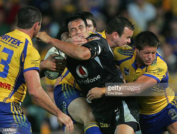 Logan Swann of the Warriors is tackled by the Eels defence during the round 11 NRL match between the Parramatta Eels and the Warriors at Parramatta...
