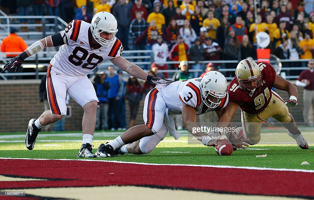 <a gi-track='captionPersonalityLinkClicked' href=/galleries/search?phrase=Logan+Thomas&family=editorial&specificpeople=6787143 ng-click='$event.stopPropagation()'>Logan Thomas</a> #3 of the Virginia Tech Hokies recovers his own fumble near the endzone against Kasim Edebali #91 of the Boston College Eagles during the game on November 17, 2012 at Alumni Stadium in Chestnut Hill, Massachusetts.