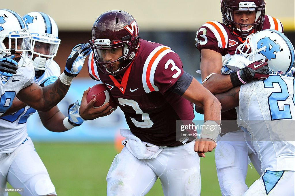 <a gi-track='captionPersonalityLinkClicked' href=/galleries/search?phrase=Logan+Thomas&family=editorial&specificpeople=6787143 ng-click='$event.stopPropagation()'>Logan Thomas</a> #3 of the Virginia Tech Hokies runs with the ball against the North Carolina Tar Heels on October 6, 2012 at Kenan Stadium in Chapel Hill, North Carolina.