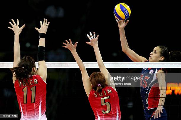 Logan Tom of the United States hits the ball ball against Erika Araki and Miyuki Takahashi of Japan at the Capital Indoor Stadium during Day 1 of the...