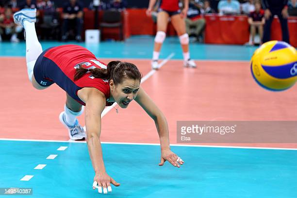 Logan Tom of United States dives for the ball in the Women's Volleyball Preliminary match between the United States and Brazil on Day 3 of the London...