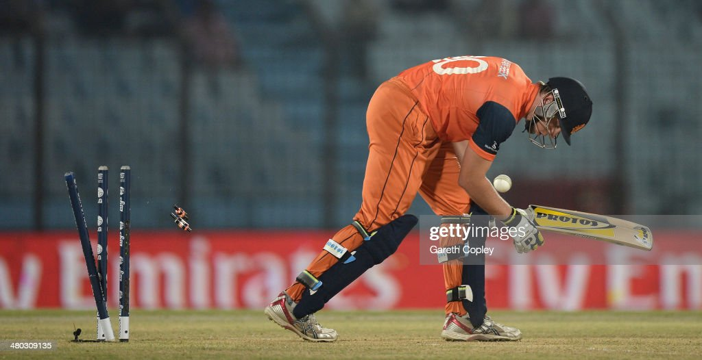 Logan van Beek of the Netherlands is bowled by Lasith Malinga of Sri Lanka during the ICC World Twenty20 Bangladesh 2014 Group 1 match between Sri Lanka and the Netherlands at Zahur Ahmed Chowdhury Stadium on March 24, 2014 in Chittagong, Bangladesh.