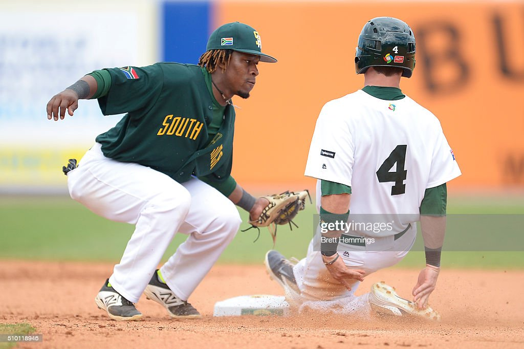 Logan Wade of Australia is run out on 2nd base by Gift Ngoepe of South Africa during the World baseball Classic Final match between Australia and South Africa at Blacktown International Sportspark on February 14, 2016 in Sydney, Australia.