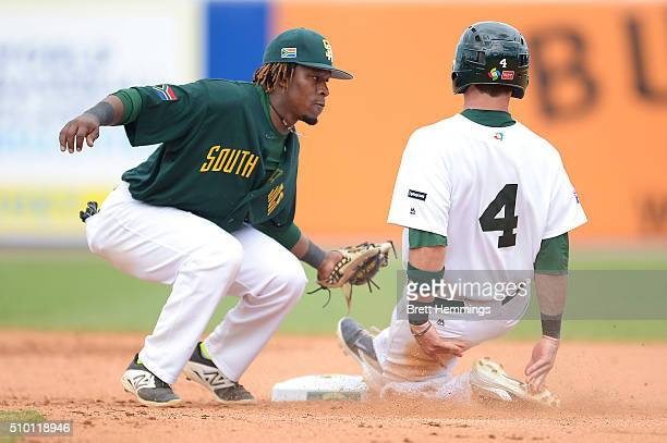 Logan Wade of Australia is run out on 2nd base by Gift Ngoepe of South Africa during the World baseball Classic Final match between Australia and...