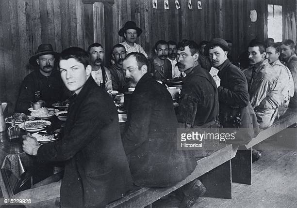 Loggers sit down for breakfast at a lumber camp Washington 1901 | Location Washington USA