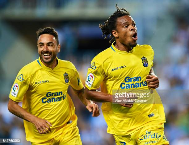 Logic Remy of Union Deportiva Las Palmas celebrates after scoring with during the La Liga match between Malaga and Las Palmas at Estadio La Rosaleda...