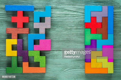 Logical tasks composed of colorful wooden shapes. Business concept. : Stock Photo