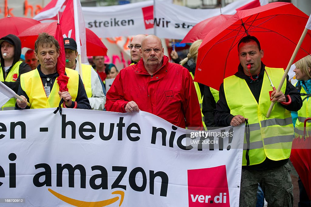 Logistic center employees of Amazon march through Bad Hersfeld, western Germany, during a strike on May 14, 2013. German employees of Amazon staged their first-ever walkouts as the US Internet retail giant was hit by a dispute over pay. Germany's giant services sector union Verdi is demanding that Amazon's 9,000 employees in Germany be paid according to a sector-wide wage deal for the retail and mail-order industries.