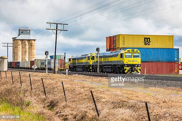 QUBE Logistics train loading shipping containers at rural terminal