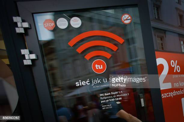 A logo advertising the availability of WiFi is seen on the entrance of a bank in the old center of the city on 19 August 2017