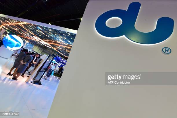 A 'DU' logo an emiratee phone network is seen at the Gitex 2017 exhibition at the Dubai World Trade Center in Dubai on October 8 2017 / AFP PHOTO /...